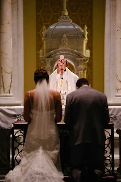 catholic wedding mass with bride groom and celebrant